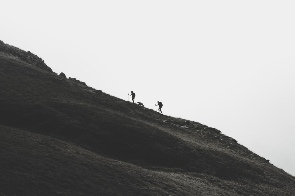 silhouette of person walking on mountain