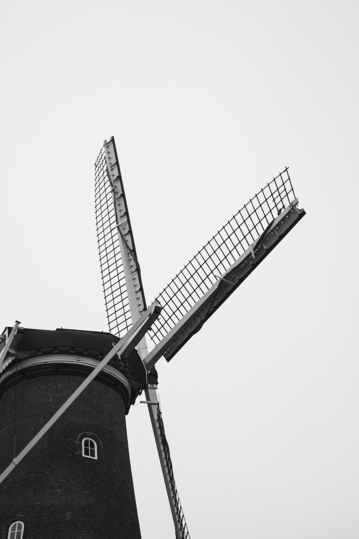 greyscale photo of windmill