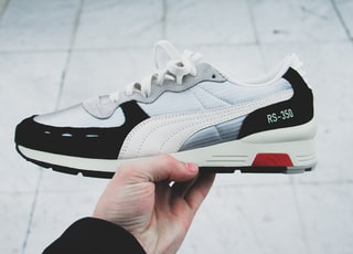white and black Puma RS-358 low-top sneaker