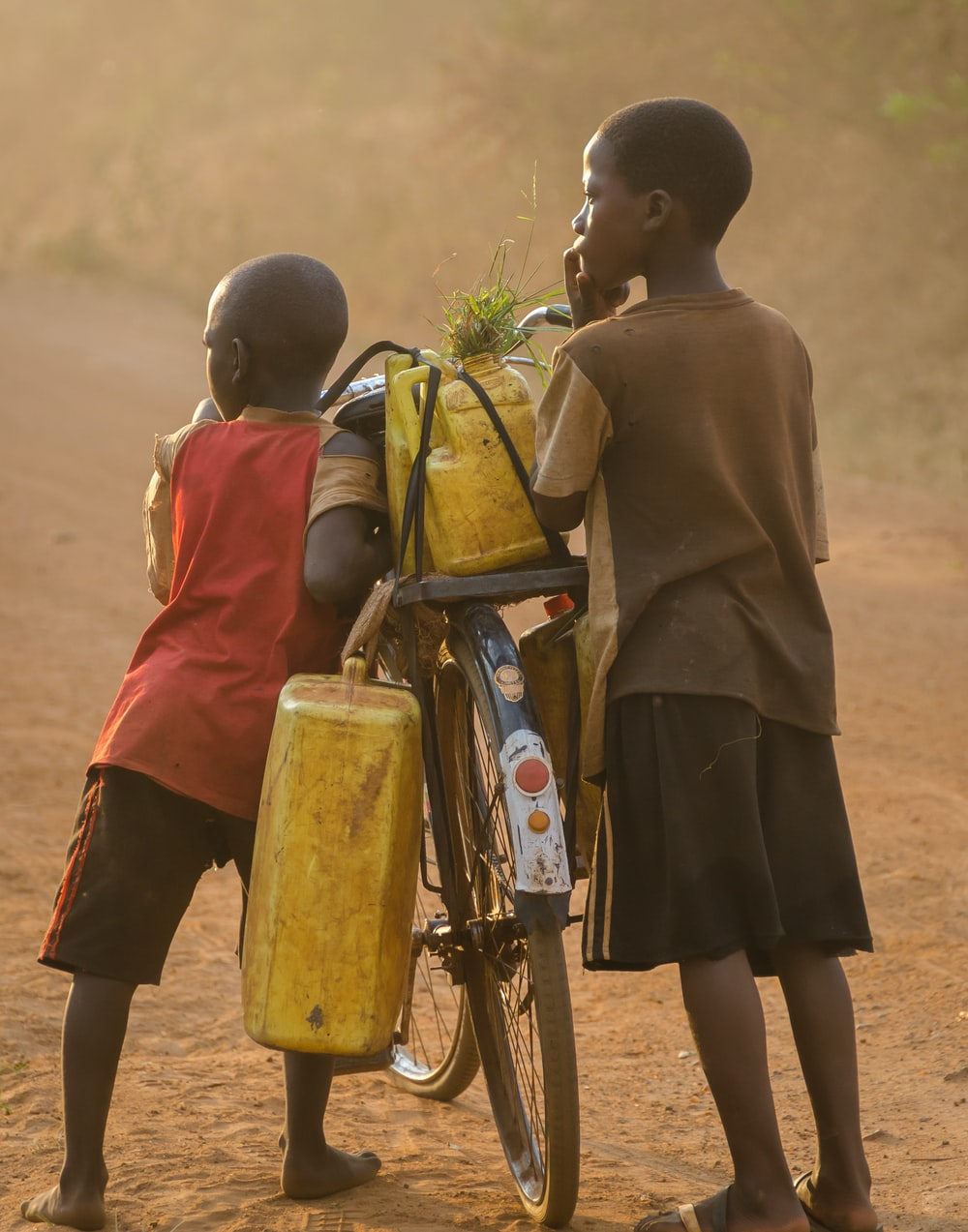 two boys beside bicycle