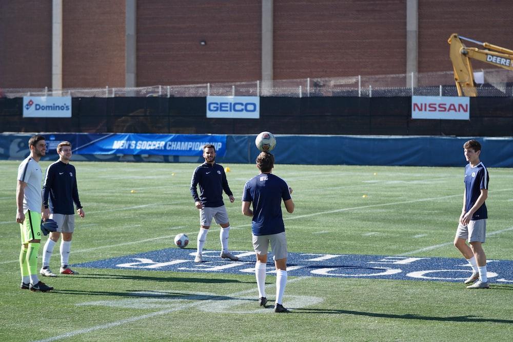 men playing soccer during daytime