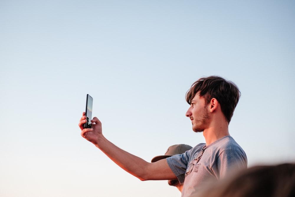 woman using black smartphone