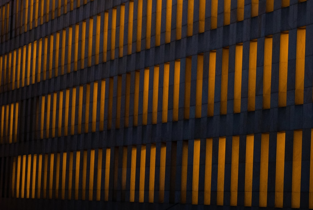 orange lighted concrete building wall