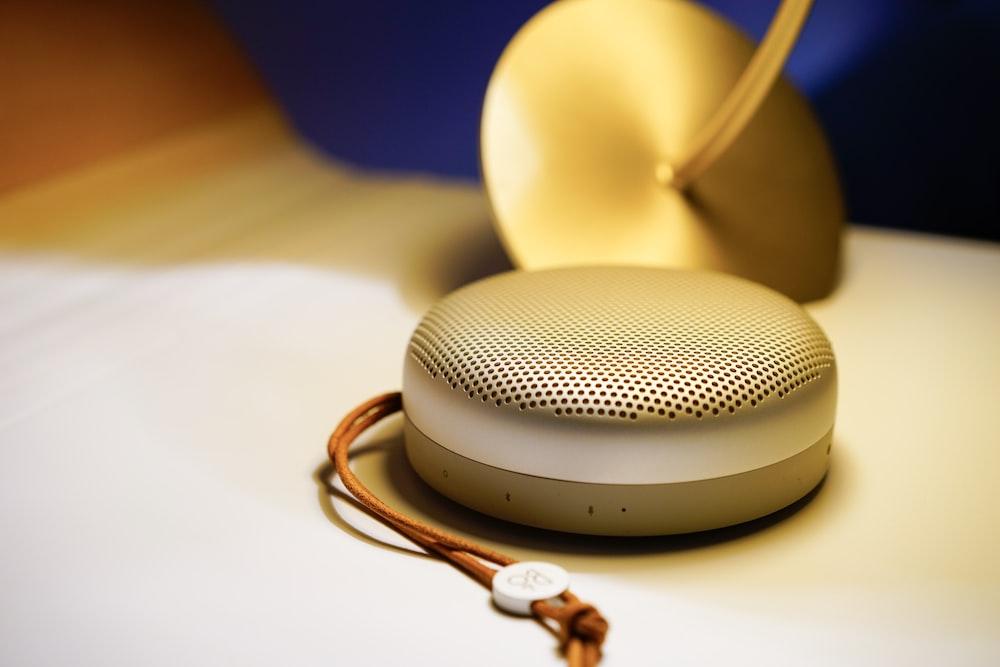 gray portable speaker on white surface