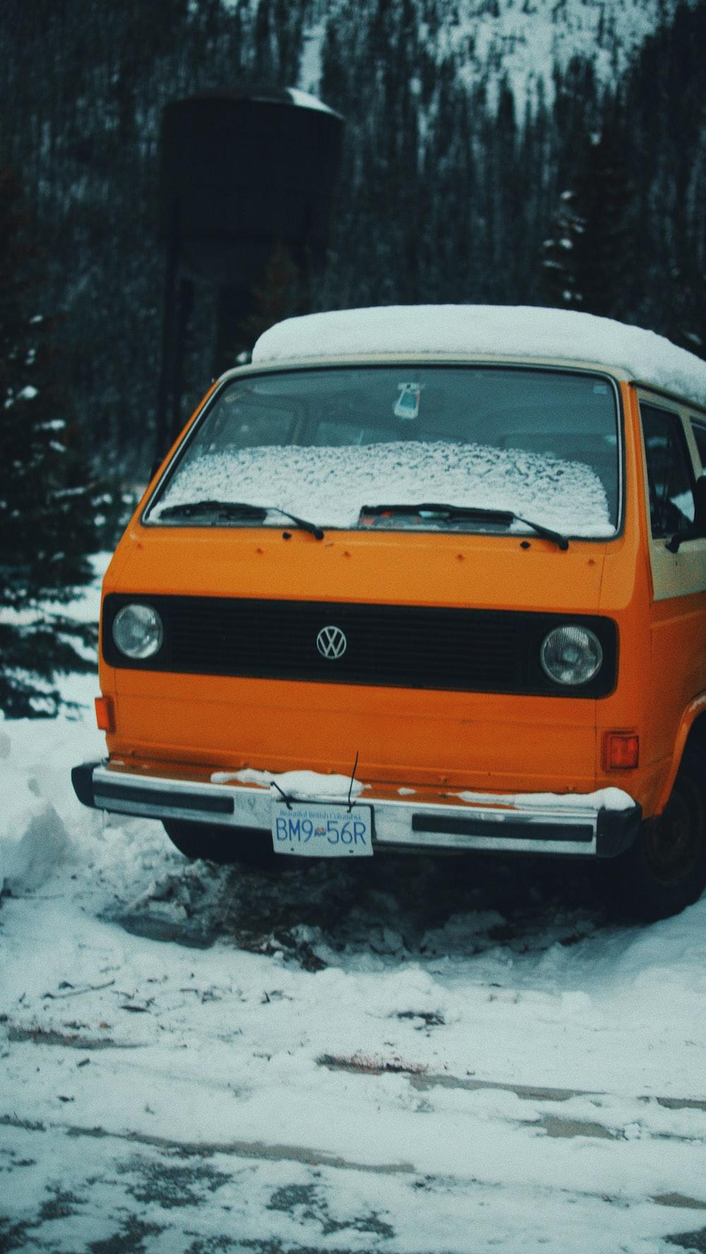 orange and white Volkswagen van