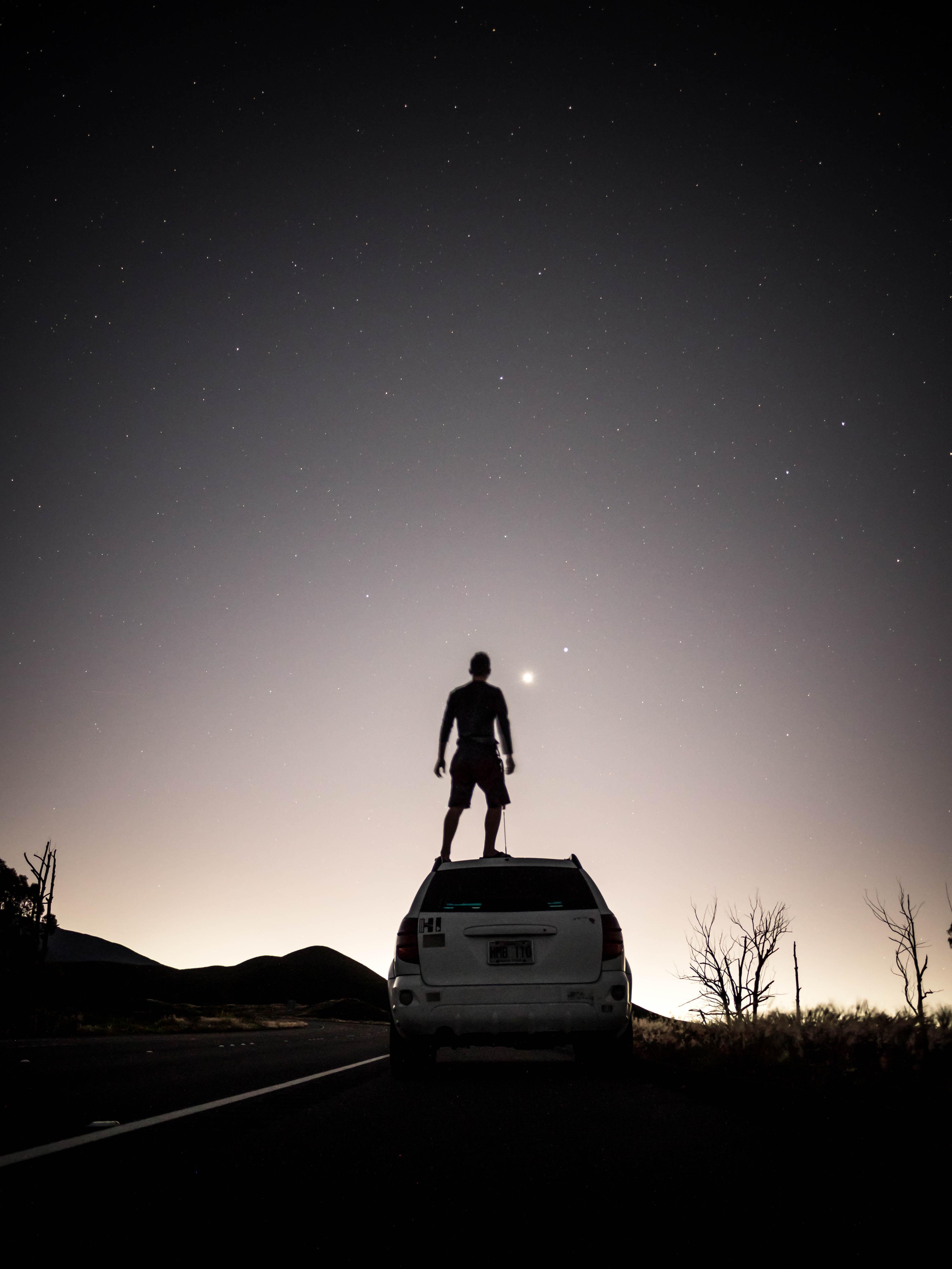 man standing on SUV