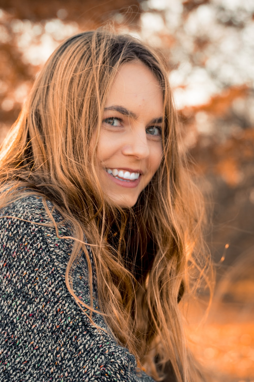 smiling woman wearing gray dress