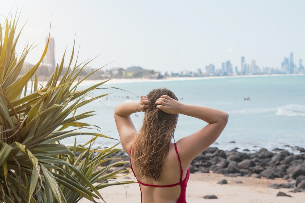 woman holding her head outdoor