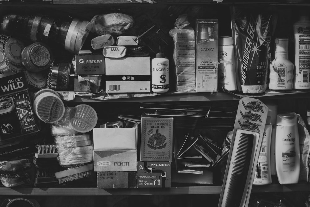 grayscale photography of assorted cosmetic products