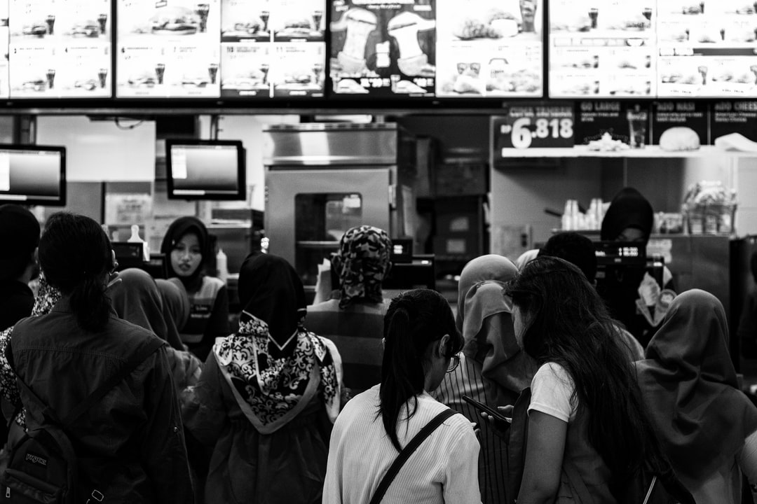 Distracted queue in fast food restaurant. Can you see the line which is better?