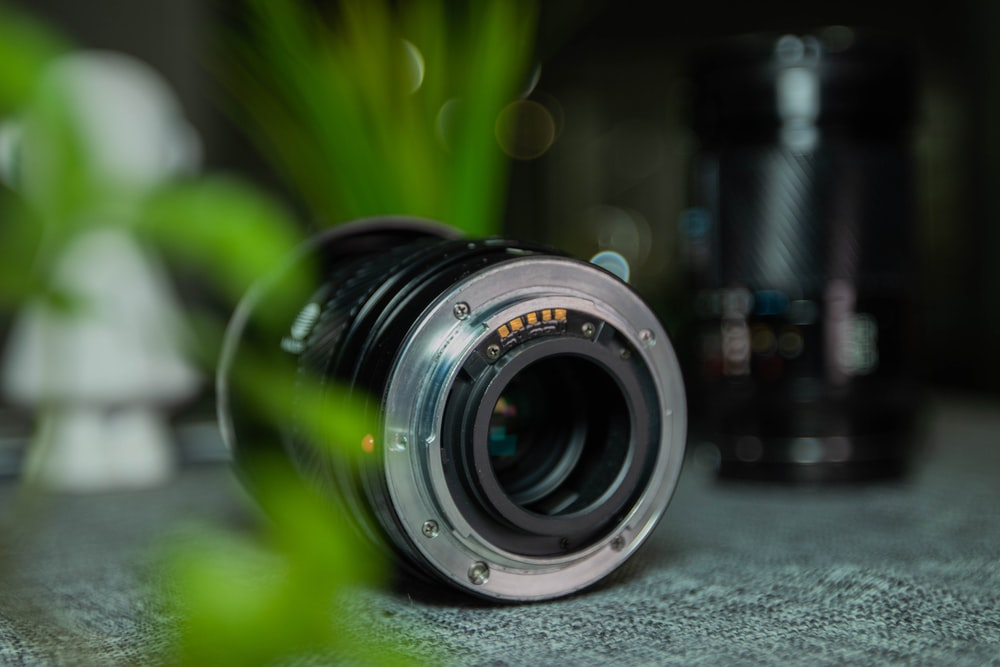 selective focus photography of black camera lens