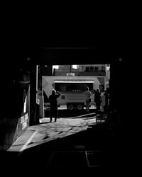 grayscale photography of multi-stop truck
