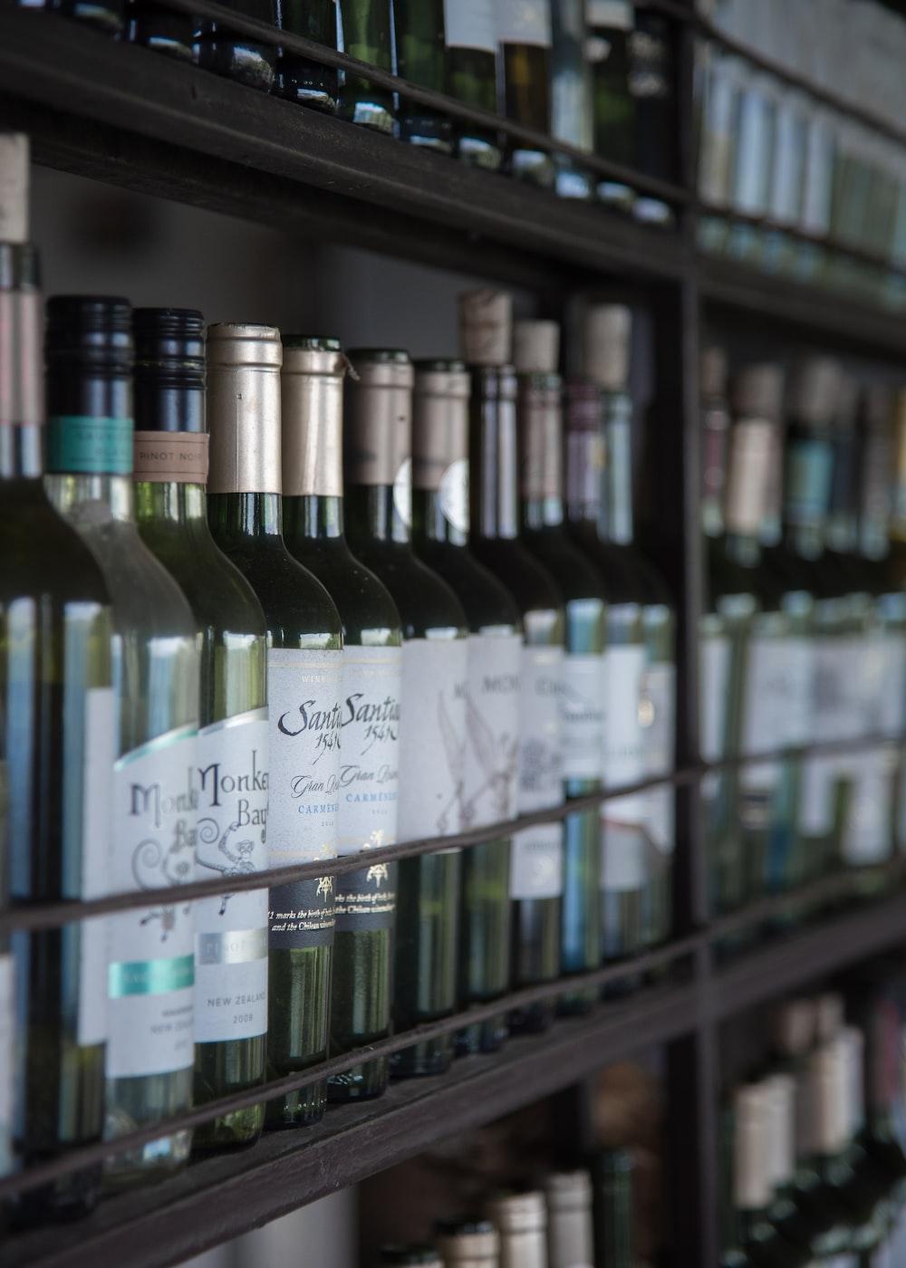 assorted liquor bottle on a rack