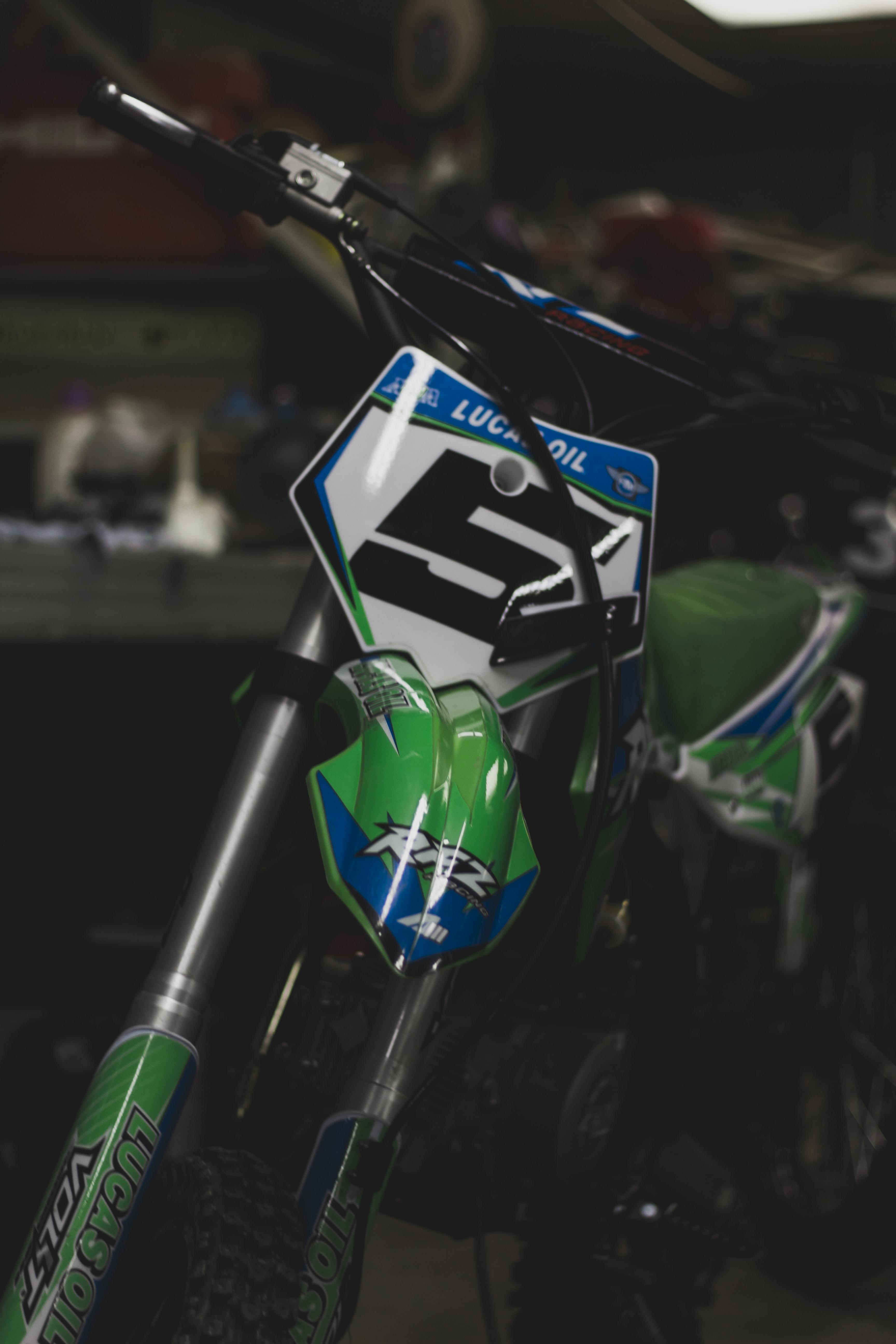 green and black motocross dirt bike