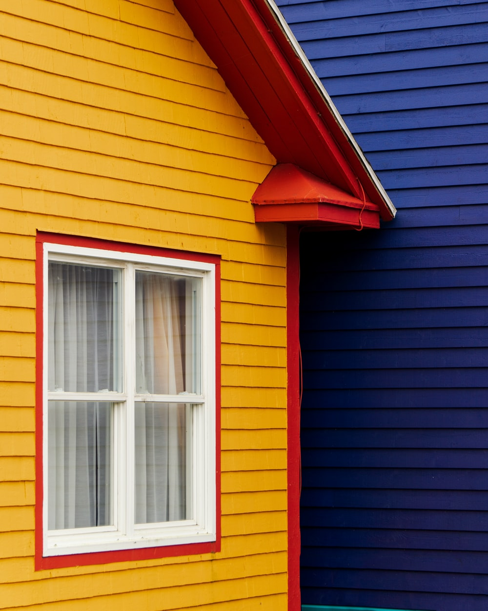 yellow and red wooden house