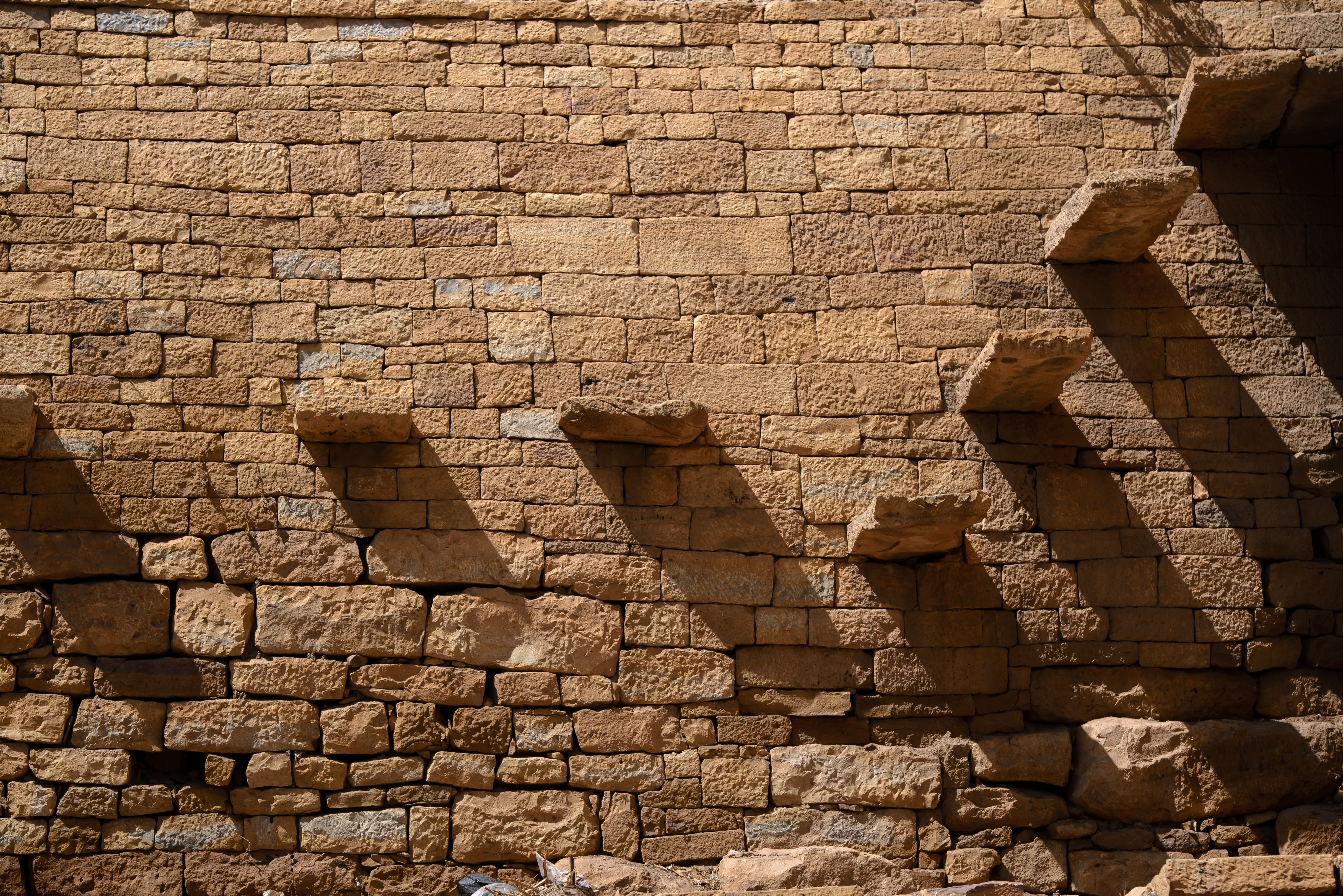 brown brick wall with stairs