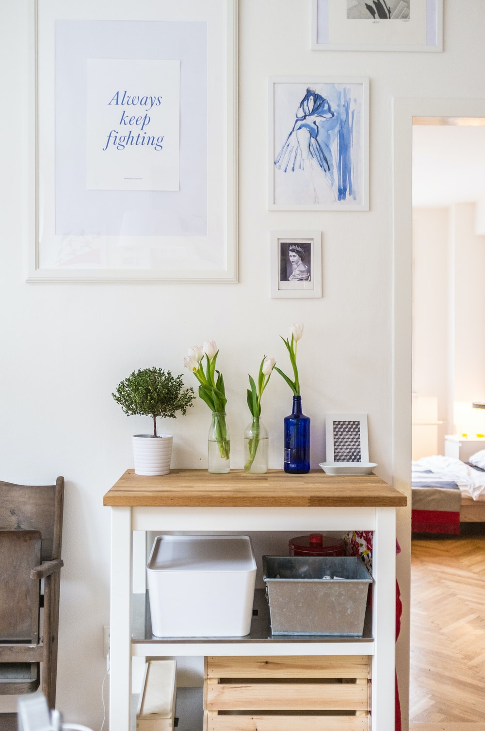 white and brown wooden end table near wall inside room
