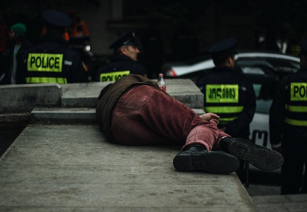 man lying on concrete island