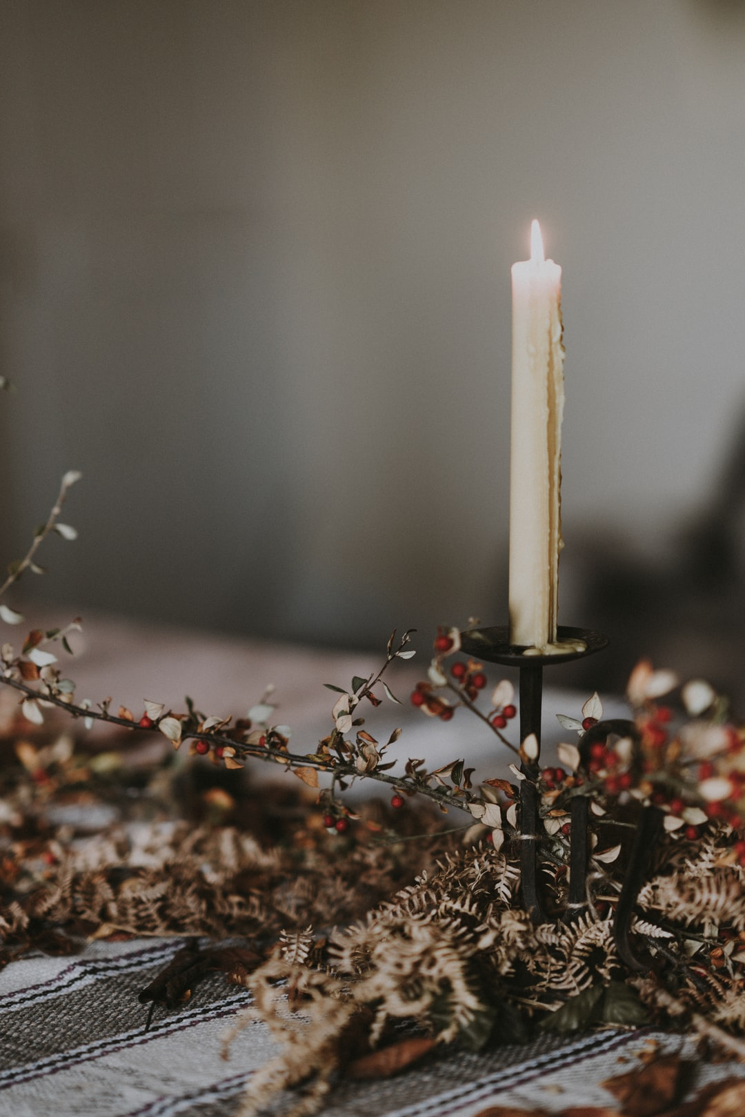 Winter table, slow living, candle burning