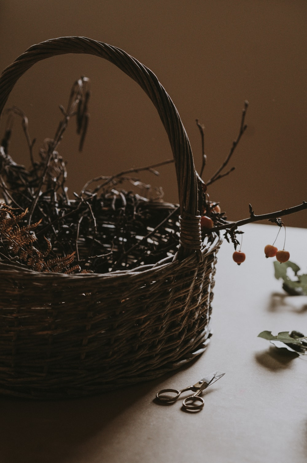brown woven basket with dried plant