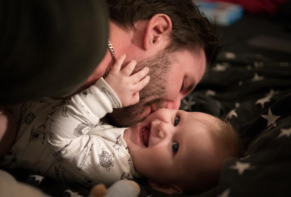 man kissing baby