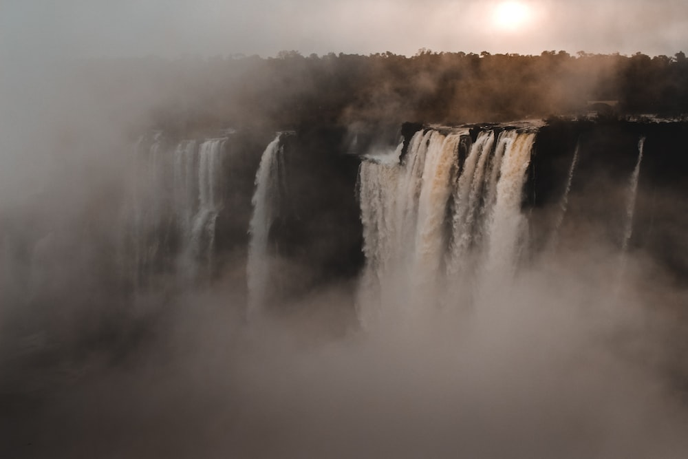 aerial photography of waterfalls at day time