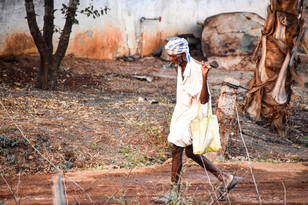 man carrying basket