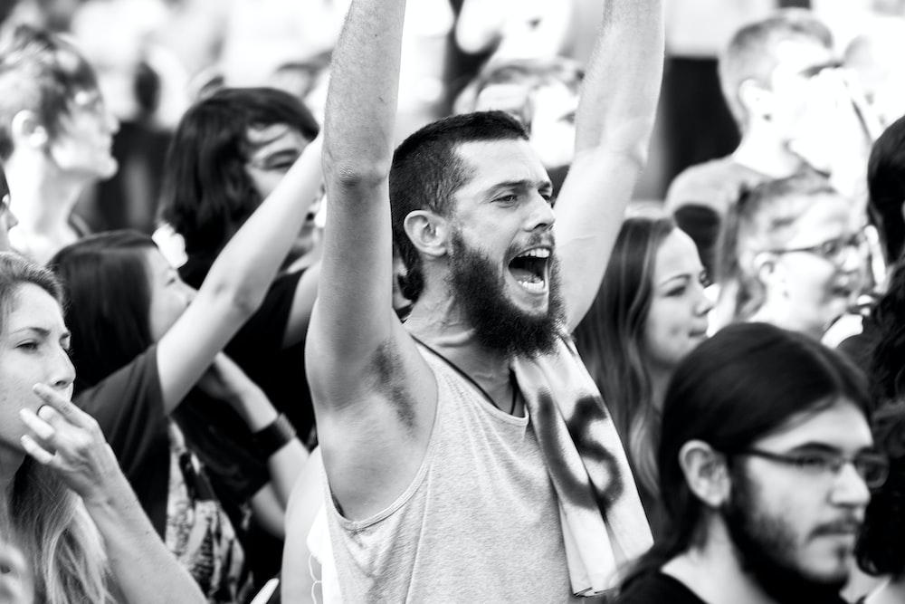 man raising hands