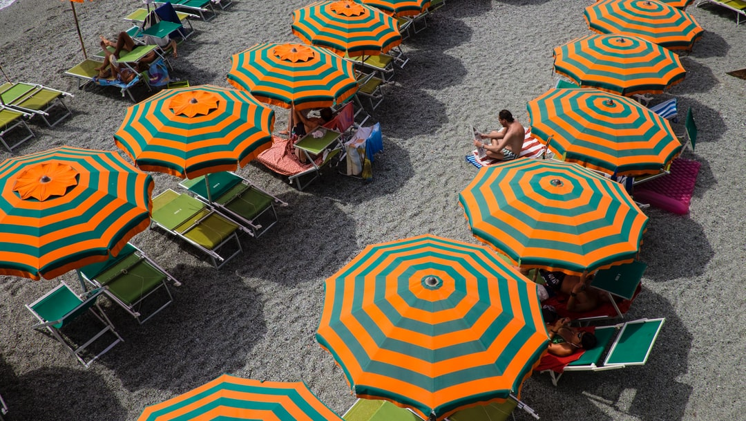 Colourful beach umbrellas seen from above