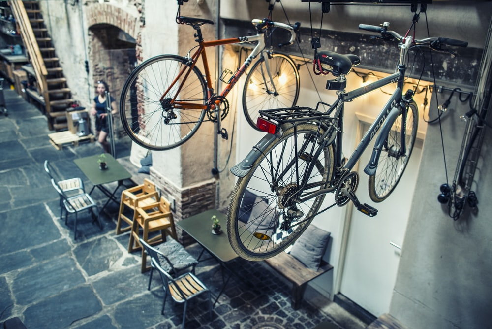 two bicycles hanging over the tables
