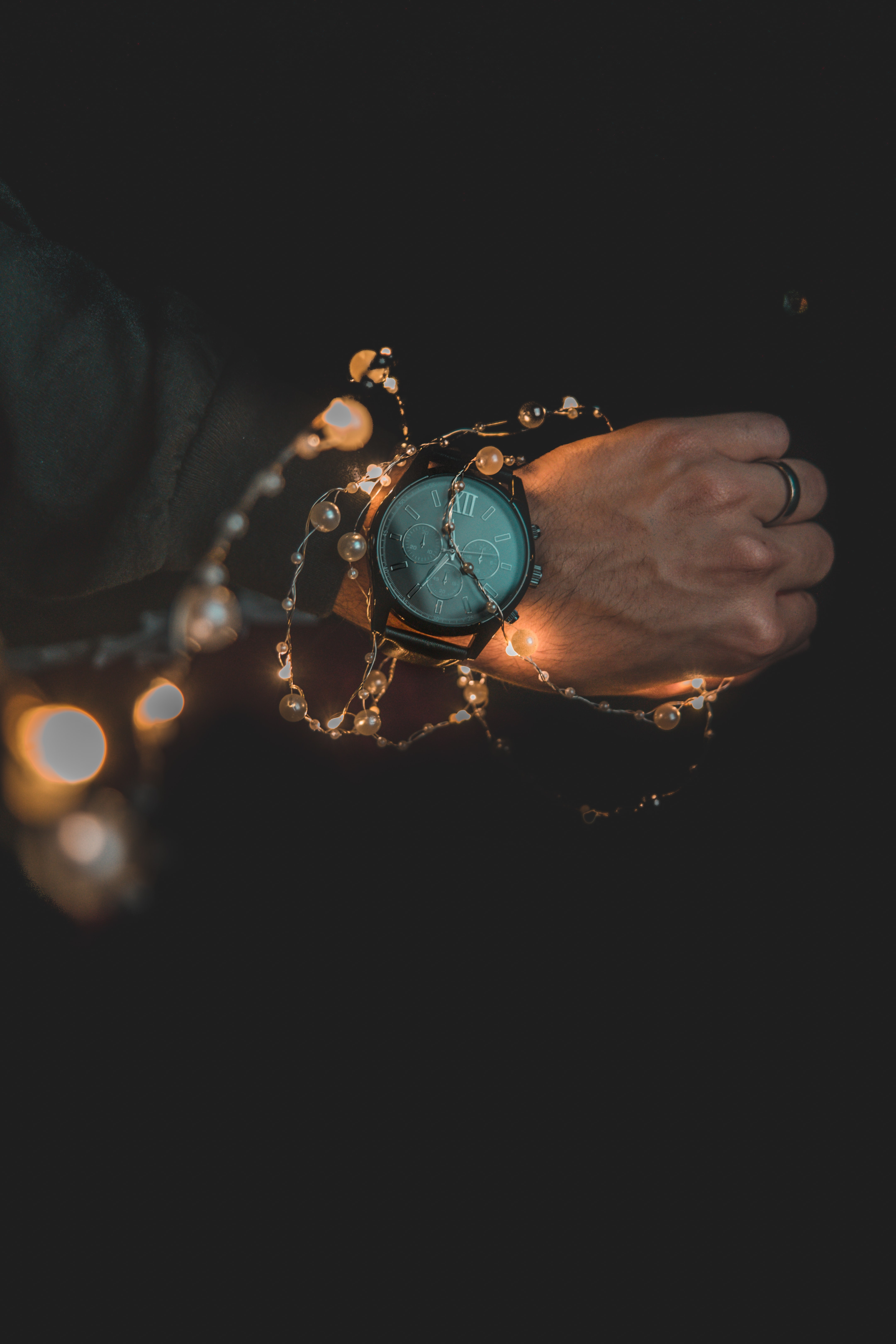 person wearing teal and black analog watch