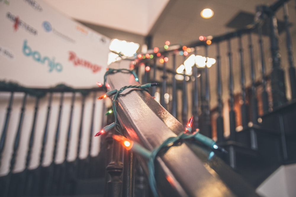 turned-on string lights on stairs