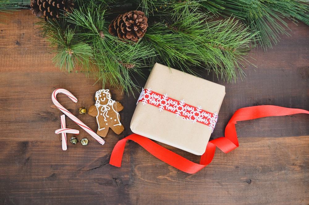 white gift box beside gingerbread