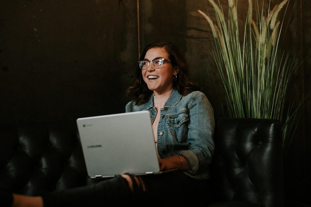 silver laptop on woman's lap