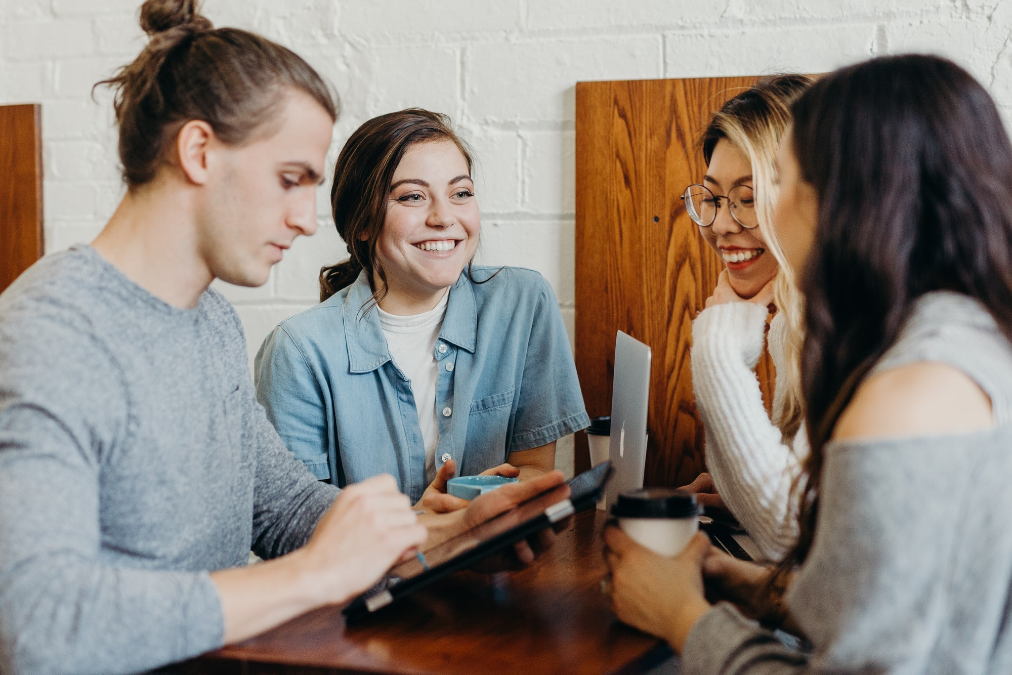 A group of four friends having a conversation.
