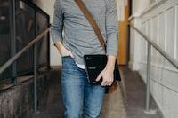 person holding black laptop in walking gesture