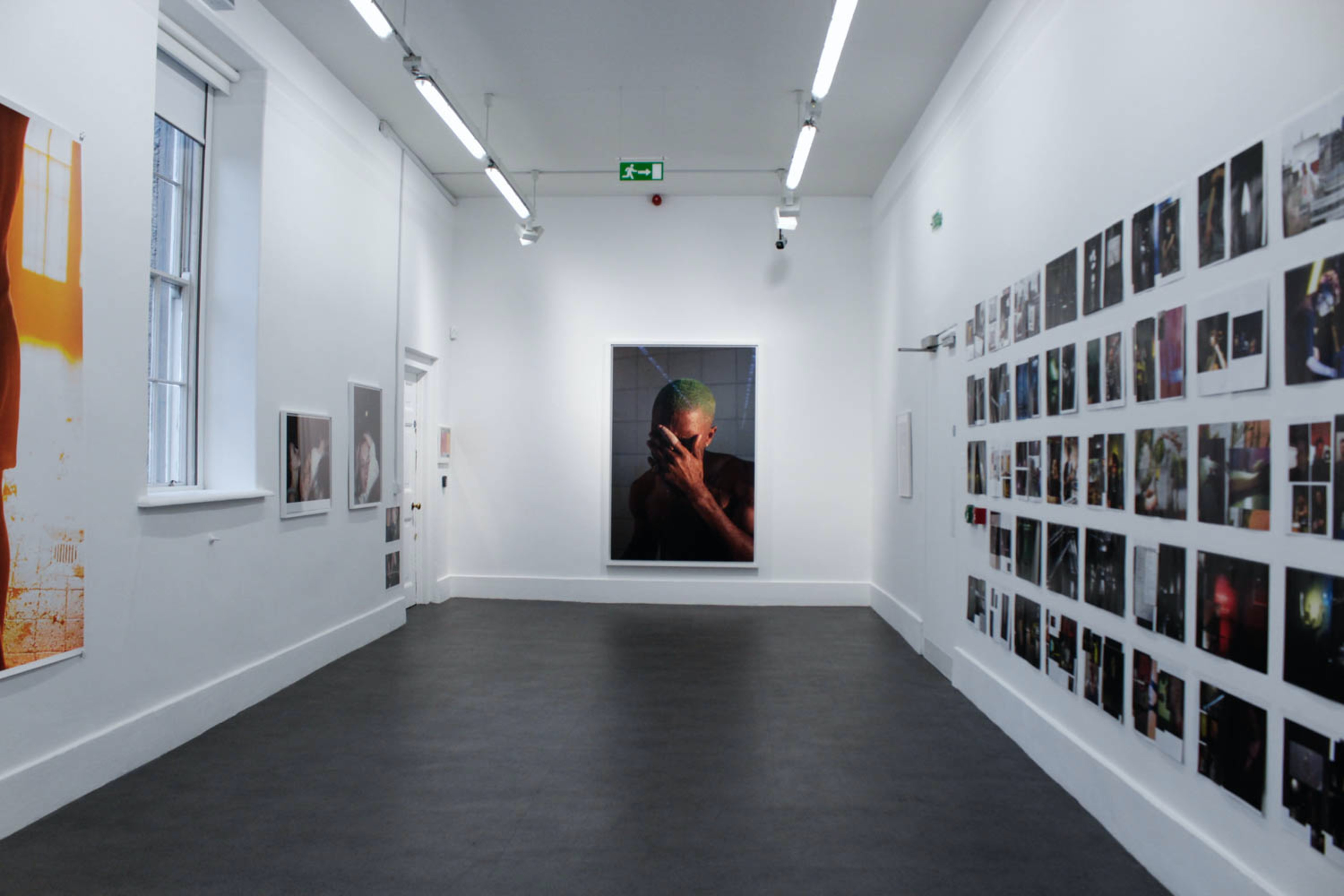 white painted room full of pictures on walls