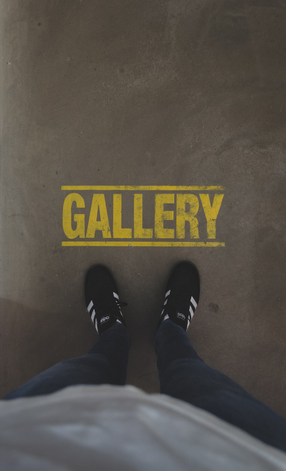 person standing infront of Gallery sign