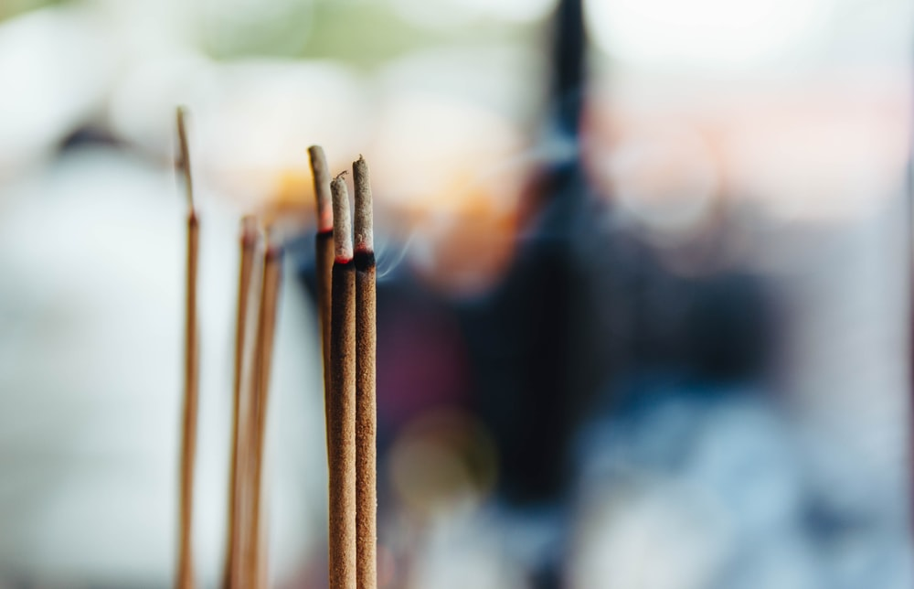 selective focus photography of incense stick