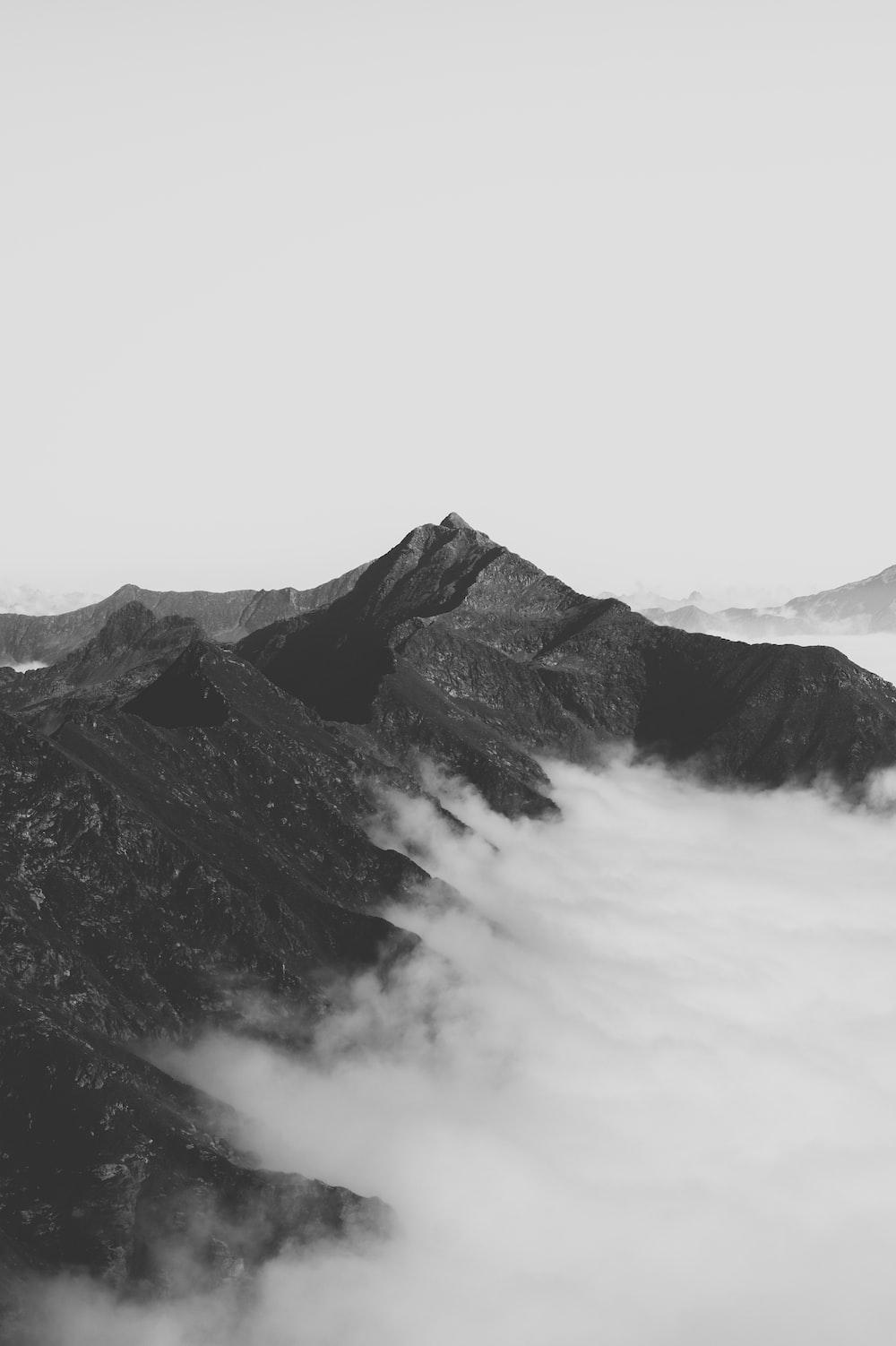 grey mountain under white sky