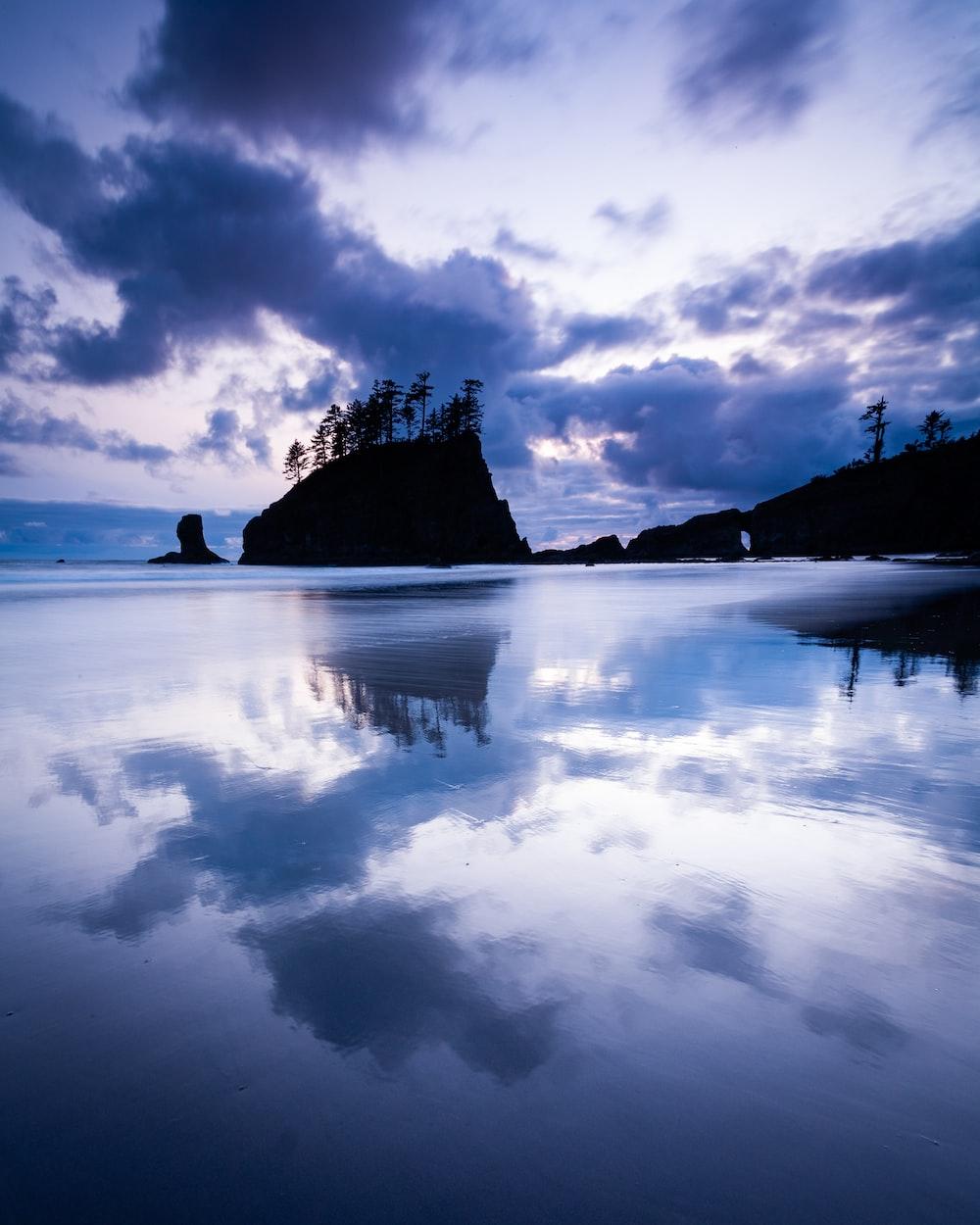 island under grey clouds during daytime