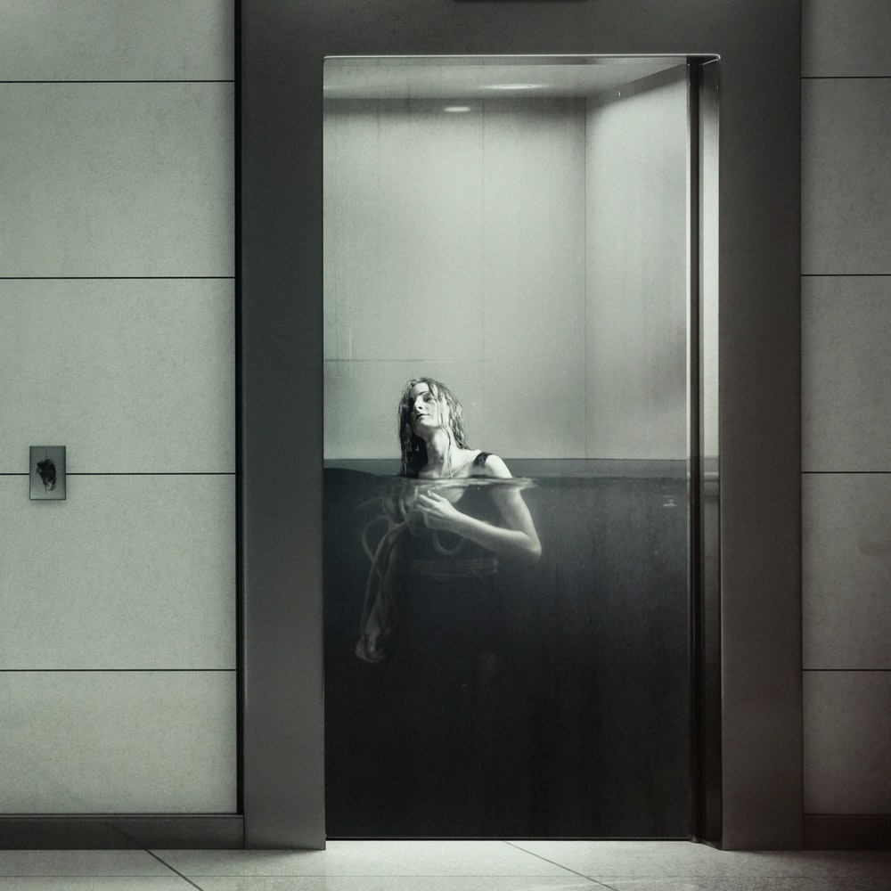 woman floating in body of water inside room