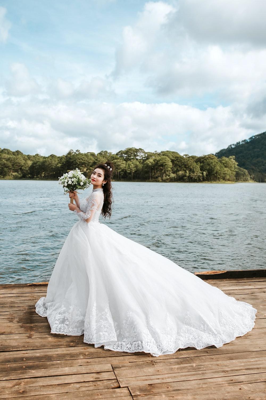 bride dress near water