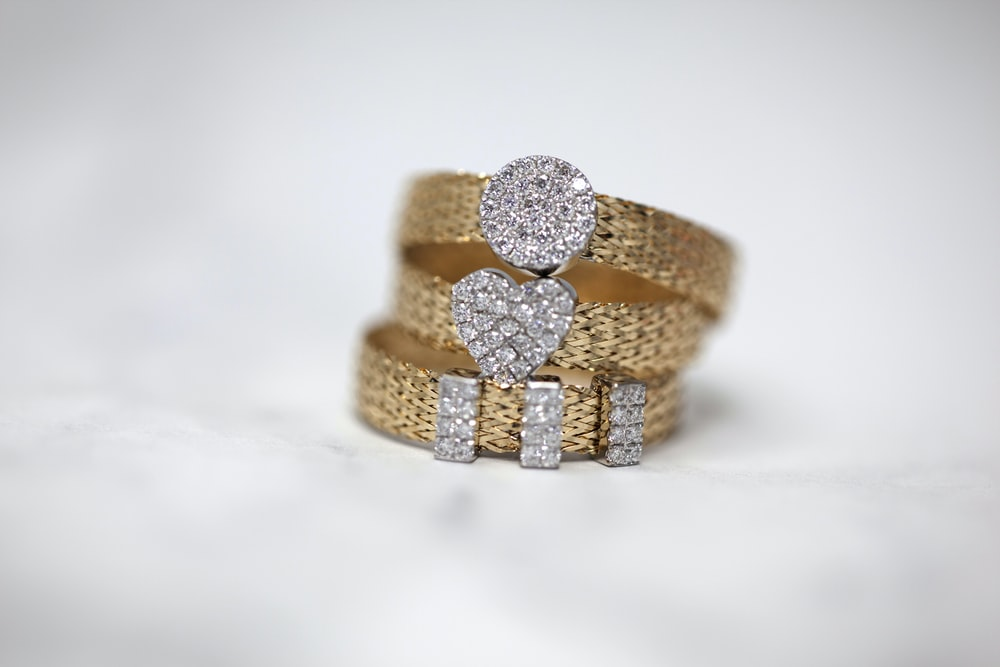 three gold-colored studded rings
