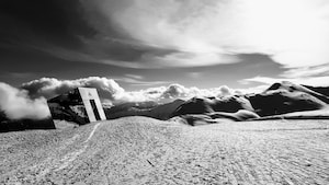 grayscale photography of desert mountain