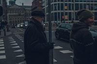 two men wearing black jacket on road during night time