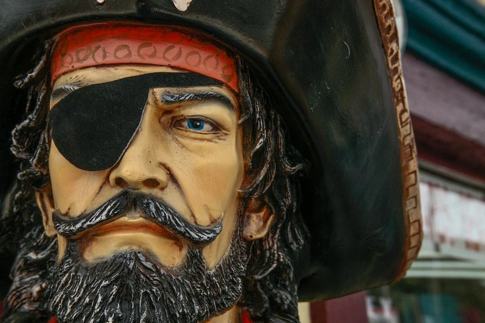 man in black pirate hat figurine
