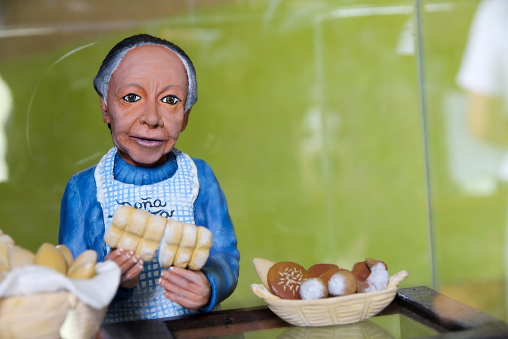 woman holding bread toy
