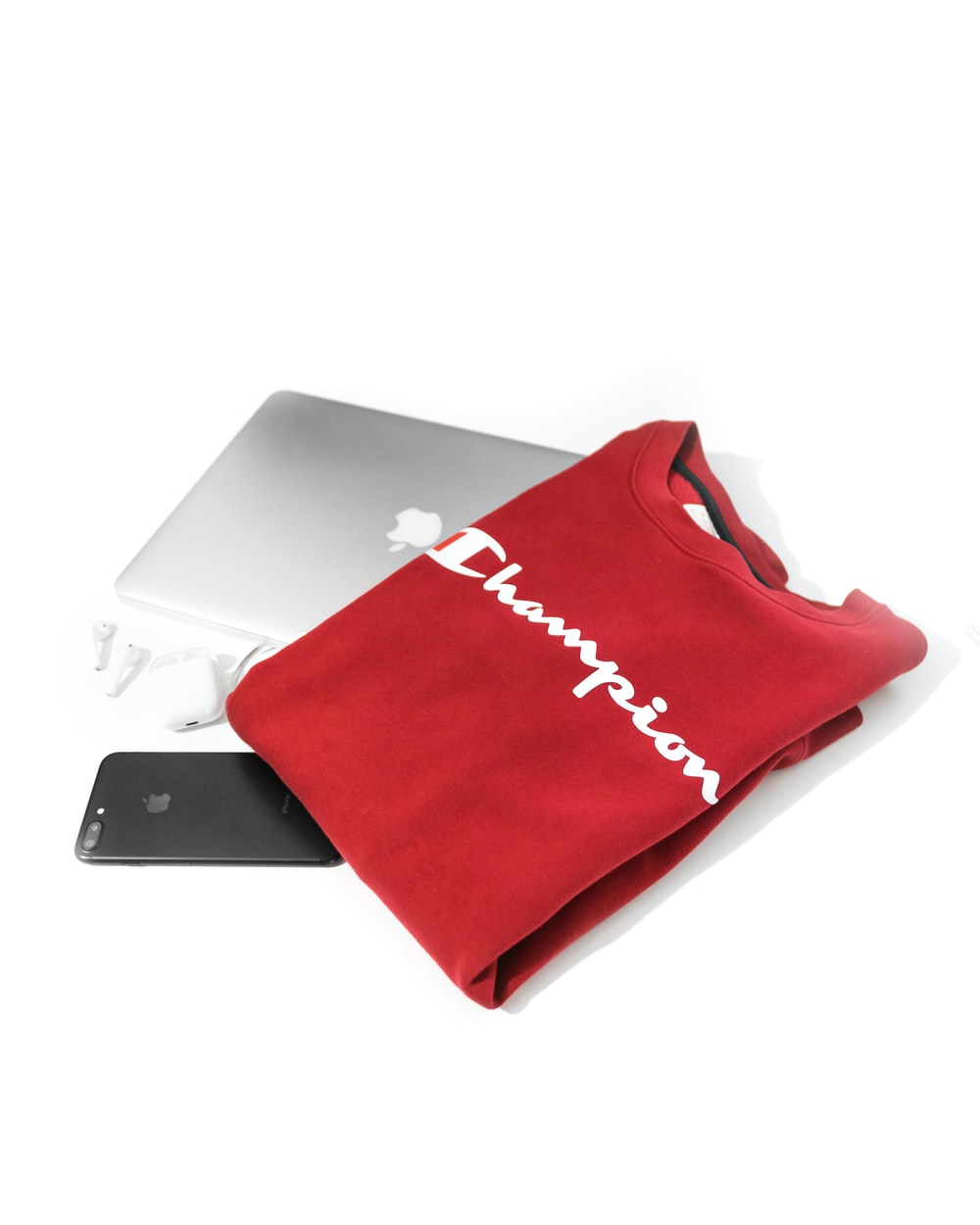 red and white Champion shirt on MacBook