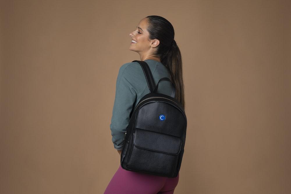 woman wearing black backpack